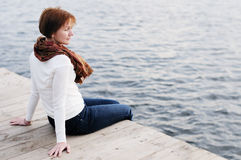 A woman sitting on wood boards Stock Photo