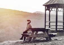 Woman sitting on the wooden bench Stock Photos