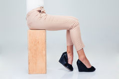 Woman sitting on wooden box Royalty Free Stock Photos