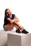 Woman sitting on wooden cubes Royalty Free Stock Image