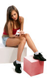 Woman sitting on wooden cubes Royalty Free Stock Photography