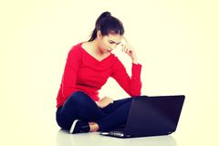 Woman sitting and working on laptop Royalty Free Stock Images
