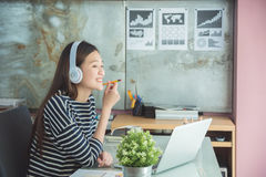 Woman sitting and working with notebook computer Royalty Free Stock Images