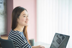 Woman sitting and working with notebook computer Royalty Free Stock Photo