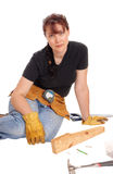 Woman sitting and working with tools. A middle age woman sitting on the floor and working with some tools Royalty Free Stock Images