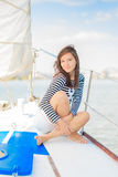 Woman sitting on a yacht Royalty Free Stock Images