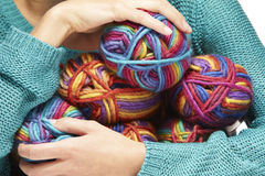 Woman sitting with yarn rolls in her arms Royalty Free Stock Photography