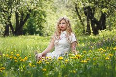 Woman Sitting on Yellow Black-eyed Susan Flower Field royalty free stock photography