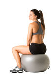 Woman Sitting on a Yoga Ball Stock Photo