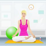 Woman sitting in yoga lotus position doing Stock Images