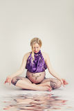 Woman Sitting in Yoga Pose Royalty Free Stock Photo