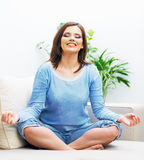 Woman sitting in yoga pose. Royalty Free Stock Image