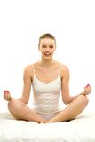 Woman sitting in yoga position Stock Photography