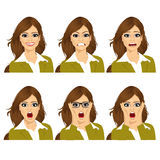 Woman on six different face expressions set. Beautiful young brunette woman on six different face expressions set Royalty Free Stock Image