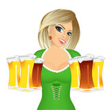 Woman with six froth beer mugs. Beautiful oktoberfest blonde young sexy woman wearing a green dirndl with six froth beer mugs Royalty Free Stock Photo