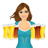 Woman with six froth beer mugs. Portrait of beautiful oktoberfest young sexy woman wearing a dirndl with six froth beer mugs Stock Images