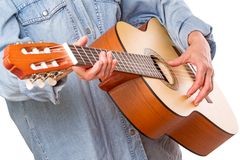 Woman and six-stringed guitar Stock Images