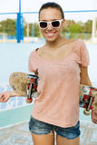 Woman with skateboard Stock Photo