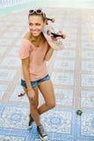 Woman with skateboard Stock Photos