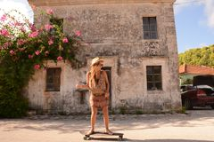 Woman on skateboard Royalty Free Stock Images