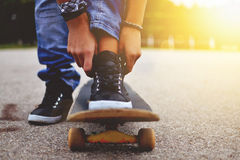 Woman with the skateboard. Outdoor shot Royalty Free Stock Image