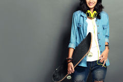 Woman with skateboard Stock Photography