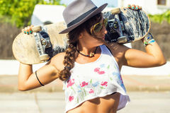 Woman with Skateboard Royalty Free Stock Image