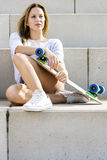 Woman With Skateboard On Steps Stock Photo