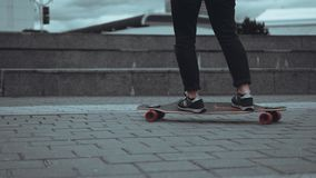 Woman skateboarder legs skateboarding at city royalty free stock photography