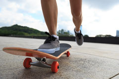 Woman skateboarder legs skateboarding Stock Image