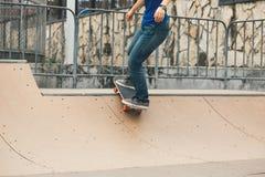 Skateboarding on city street Stock Photo