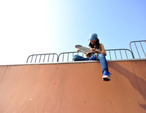 Woman skateboarder at skatepark Royalty Free Stock Image
