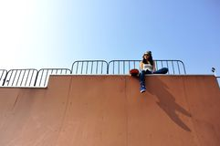 Woman skateboarder at skatepark Royalty Free Stock Photography