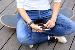 Woman skateboarder use cellphone taking photo Royalty Free Stock Photo