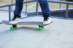 Woman skateboarders riding on a skateboard Stock Images