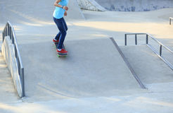 Woman skateboarders riding on a skateboard Royalty Free Stock Photography