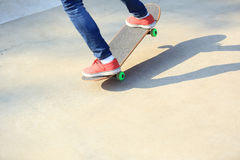 Woman skateboarders riding on a skateboard Royalty Free Stock Image