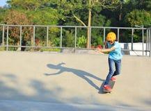 Woman skateboarders riding on a skateboard Stock Photos
