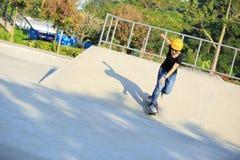 Woman skateboarders riding on a skateboard Royalty Free Stock Photo