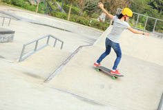 Woman skateboarders riding on a skateboard Stock Photo
