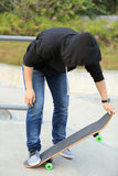Woman skateboarders riding on a skateboard Royalty Free Stock Images