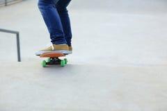 Woman skateboarders riding on a skateboard Royalty Free Stock Photos