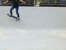 Woman skateboarders riding on a skateboard Stock Image