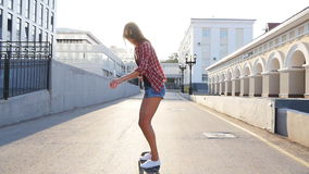 Woman skateboarding at sunrise. Legs on the skateboard, moves to success stock footage