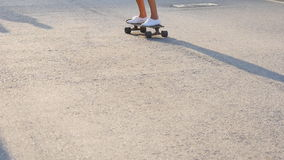 Woman skateboarding at sunrise. Legs on the skateboard, moves to success stock video