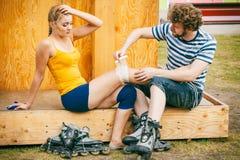 Woman skater with injured leg knee Stock Photo