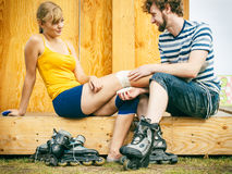 Woman skater with injured leg knee Royalty Free Stock Images