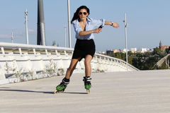 Woman skater speeding with a skirt. In Zaragoza, Spain Stock Image