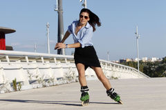 Woman skater speeding to the right with a skirt. In Zaragoza, Spain Stock Photography