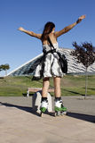 Woman with skates opening her arms. In Zaragoza, Spain Stock Photography